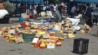 Boxes and goods lay scattered after foreign nationals were attacked on Sunday.
