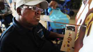 Brendon Swartz uses his skill of painting with his mouth to inspire severely disabled children. Picture: Cindy Waxa/Cape Argus
