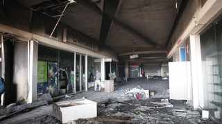 Bridge City shopping centre was one of the buildings destroyed by looters during last week' violent protests. Picture: Motshwari Mofokeng/African News Agency (ANA)
