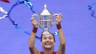 Britain's Emma Raducanu celebrates with the trophy after winning the 2021 US Open. Photo: Kena Betancur/AFP
