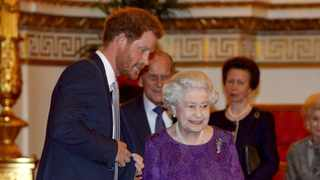 Britain's Prince Harry and Queen Elizabeth look at the Webb Ellis Cup on a plinth during a Rugby World Cup reception at Buckingham Palace, London October 12, 2015. Picture: Reuters/Anthony Devlin/Pool TPX