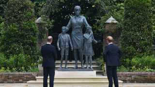 Britain's Prince William, Duke of Cambridge (L) and Britain's Prince Harry, Duke of Sussex unveil a statue of their mother, Princess Diana at The Sunken Garden in Kensington Palace, London on July 1, 2021. Picture: Dominic Lipinski / POOL / AFP