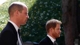 Britain's Prince William, Duke of Cambridge and Britain's Prince Harry, Duke of Sussex follow the coffin during the ceremonial funeral procession of Britain's Prince Philip, Duke of Edinburgh to St George's Chapel in Windsor Castle in Windsor, west of London. Picture: Alastair Grant/POOL/AFP