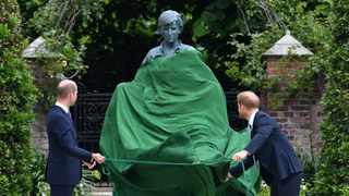 Britain's Prince William, The Duke of Cambridge, and Prince Harry, Duke of Sussex, look at a statue they commissioned of their mother Diana, Princess of Wales, in the Sunken Garden at Kensington Palace, London, Britain July 1, 2021. Picture: Dominic Lipinski/Pool via REUTERS