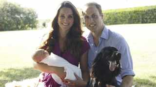 Britain's Prince William and his wife Catherine, Duchess of Cambridge, pose in the garden of the Middleton family home with their son Prince George and cocker spaniel Lupo. Picture: Handout via Michael Middleton and the Duke and Duchess of Cambridge