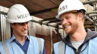 Britain's Prince William, left, and Prince Harry smile during a visit to a building site in Manchester England. Wednesday Sept. 23, 2015. Picture: Andy Stenning/Pool via AP