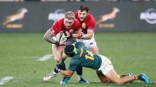 British and Irish Lions' full back Stuart Hogg is tackled by South Africa's wing Cheslin Kolbe. Photo: Phil Magakoe/AFP