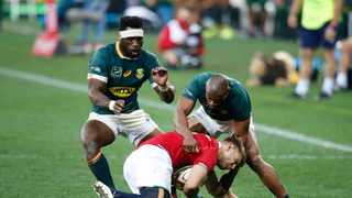 British and Irish Lions' scrum-half Conor Murray is tackled by South Africa's flanker Siya Kolisi South Africa's wing Makazole Mapimpi during the second rugby union Test match between South Africa and the British and Irish Lions at The Cape Town Stadium in Cape Town on July 31, 2021. (Photo by PHILL MAGAKOE / AFP)