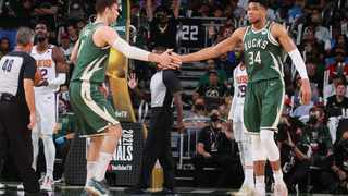 Brook Lopez #11 hi-fives Giannis Antetokounmpo #34 of the Milwaukee Bucks during Game Three of the 2021 NBA Finals. Photo: Nathaniel S. Butler/Getty Images via AFP