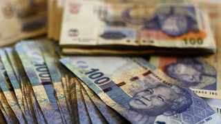 Businesses and households are encouraged to curb spending and to grow their savings. File image. Picture: Reuters/Siphiwe Sibeko