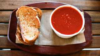 Buttery grilled cheese sandwiches oozing with molten strands of aged cheddar could be what your bowl of soup is missing. Picture: Flickr.