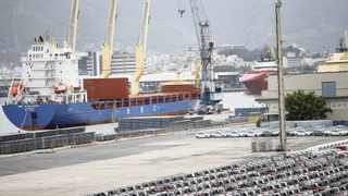 CARS IN THE port of Rio de Janeiro. Just as the Brazilian economy continued to grow after the country's credit was downgraded to junk status in 2015, the wheels of South Africa's economy will continue to turn, even if it is downgraded to junk, says the writer.     Reuters