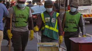 CCID cleaning staff in Burg Street, Cape Town were seen wearing surgical masks and gloves while going about their cleaning duties. Picture: Tracey Adams/African News Agency (ANA)