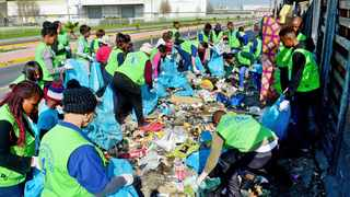 CLEANING UP: ASEZ, a global group of university student volunteers, operates in 175 countries. Its goal is to 'Save the Earth, from A to Z, from one end of the Earth to the other', with 'SAVE activities': social service, awareness raising, victim relief, and environmental protection. About 100 people helped clean up Omuramba road near Joe Slovo Park in Milnerton yesterday. Picture: David Ritchie