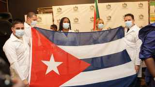 CUBAN doctors holding their national flag in Pietermaritzburg. More than R32 million was spent on 28 Cuban doctors who were fighting Covid-19 in Gauteng. Picture: Bongani Mbatha/African News Agency (ANA) Archives