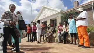 Cape Town 09.02.13 Bredasdorp community sits outside the Magistrate Court waiting of the accused number 2 to appear. Anene Booysen (17) was brutility raped and murdered on Friday last week at a construction site where she was employed. picture : neil baynes