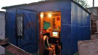 Cape Town - 111025 - After many years in darkness, the City of Cape Town and Eskom have started installing electricity in the Never Never informal settlement in Philippi. Pictured is Sandiswa Velem. Reporter: Sibusiso Nkomo Picture: David Ritchie