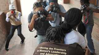 Cape Town-120201-The four men accused of the rape and murder of lesbian Zoliswa Nkonyana were each sentanced to 18 years in prison at the Khyelitsha Magistrate Court today. In pic: The mother of the deseased Monica Mandindi had to be escorted out through an unknown exit after being houded by the press-Reporters-Jade-Photographer-Tracey Adams