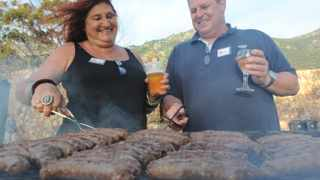"""Cape Town - 121213 - Laertes """"Tubby"""" Melidonis and Elaine Ensor-Smith won the first season of The Ultimate Braai Master. They are pictured here at the """"after-party"""" held at The Cape Point Vineyards in Noordhoek. Reporter: Esther Lewis PICTURE: DAVID RITCHIE"""