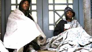 """Cape Town - 130624 - Two homeless, Jessica Pietersen and Calvin Stoltz, sleep on the streets in town beacuse they """"are used to sleeping here"""", preferring it to Salt River or Woodstock, despite recieving less harassment from CCID and police there. Jessica is from Kraaifontein, and Calvin from Mitchell's Plain. After serving time for stabbing a number of people in high school, he cannot get work, and so lives on the street, surviving off R2 cups of soup, and R0.20 slices of bread from a church, which him and Jessica share, making money from begging. PICTURE: THOMAS HOLDER. REPORTER: SHIREEN."""