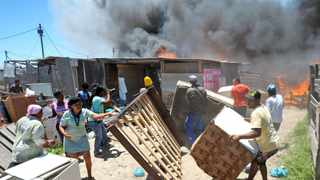 Cape Town - 131223 - A fire broke out in the Valhalla Park informal settlement. Eighteen people have been hurt and about 350 shacks have been gutted in the blaze. It is estimated around 1,400 people have been left homeless. Picture: David Ritchie