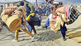 Cape Town 140602- People from Siyanyanzela informal settlement in Lwandle remove their belongings during the eviction . Picture Cindy waxa.Reporter Argus