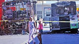 Cape Town - 140901 - Pictured burnt busses at the Nyanga Taxi rank. 6 busses were torched and a man was killed as taxi drivers went on strike today. Picture: David Ritchie (083 652 4951)