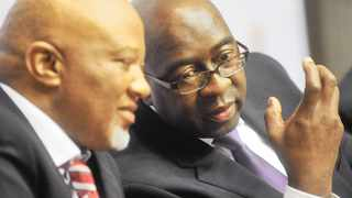 Cape Town. 141022. Finance Minister Nhlanhla Nene speaking to his deputy Mcebisi Jonas (R) at the Mid Term Budget Policy Statement(MTBPS) today at Parliament. Pic COURTNEY AFRICA