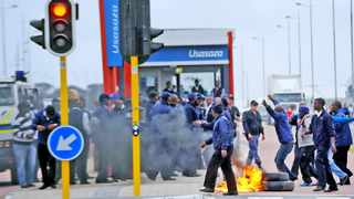 Cape Town - 141029 - Dozens of MyCiTi bus drivers embarked on a wildcat strike and abandoned their buses at the Table View bus stop and walked to the Usasaza station in Dunoon where they were joined by the community members who set alight tyres in the MyCiTi bus lane. The police dispersed the crowd with stun grenades and rubber bullets. Reporter: Chelsea Geach Picture: David Ritchie