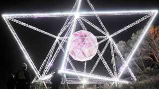 """Cape Town - 141118 - Project managers and workers did a final test run of lighting of the SunStar before the big """"unveiling"""" event tomorrow evening. The ball inside the SunStar is made using parts of the fence that once surrounded Robben Island. It is believed it will remain on Signal Hill for 6 months and will have 24/7 security onsite to make sure no one climbs on it. Picture: David Ritchie"""