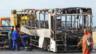Cape Town 160302- A bus torched alight last night in Delft. Picture Cindy Waxa.Reporter Argus