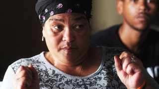 Cape Town 23-11 14 -Delia Adonis who was beaten outside a night club in Claremont with her son Tesh-Lee in her home in MAnenberg . Picture Brenton Geach
