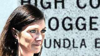 Cape Town - 24-02 -14- Sarah Tallman who is the widow of Chris who drowned in on a shark operators boat leaves the High Court who is Picture Brenton Geach