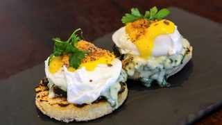 Cape poached eggs and creamed spinach toasted English muffins. Picture: Supplied