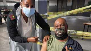 Captain Wayne Peters from the Durban Explosives Unit receives his vaccination. Picture: SAPS