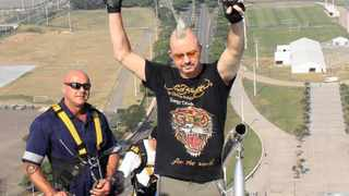 Caption: AT the top! Quadraplegic Mark Charlesworth raises his arms in triumph after climbing the 550 steps of the 106-metre Moses Mabhida stadium arch yesterday. Charlesworth who lost the use of his legs in a car crash in 2004 made the climb yesterday for charity. Picture: Colleen Dardagan