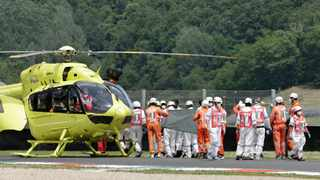 CarXpert PruestelGP's Jason Dupasquier is carried to an helicopter after sustaining an injury during Moto3 qualifying. He died on Sunday after succuming to his injuries. Photo: Ciro De Luca/Reuters