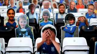 Cardboard cutouts of football fans are placed in stands as clubs try to increase revenue and add some atmosphere into the stadiums, on the day of a football match between Birmingham City and Watford at St Andrew's, during the coronavirus disease (COVID-19) outbreak, in Birmingham, Britain, December 12, 2020. REUTERS/Carl Recine