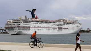 Carnival Cruise Line said it was unlikely the woman caught the virus on board. (AP Photo/Lynne Sladky)