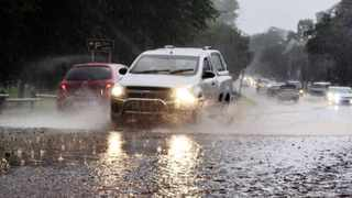 Cars make their way through a downpour on Jan Smuts Avenue near Zoo Lake on Wednesday. Picture: Christopher Tifflin
