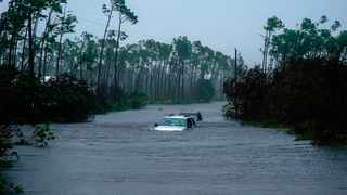 Cars sit submerged in water from Hurricane Dorian in Freeport, Bahamas, on Tuesday, Sept. 3, 2019. A larger but weakened Hurricane Dorian began lashing the east coast of central Florida late on Tuesday. (AP Photo/Ramon Espinosa)