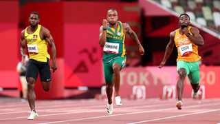 Cejhae Greene of Antigua and Barbuda, Akani Simbine of South Africa and Arthur Cisse of Ivory Coast in action during Heat 6. Photo: Lucy Nicholson/Reuters
