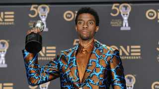 """Chadwick Boseman with the award for outstanding actor in a motion picture for """"Black Panther"""" at the NAACP Image Awards, Los Angeles, on March 30, 2019. Picture: AP"""