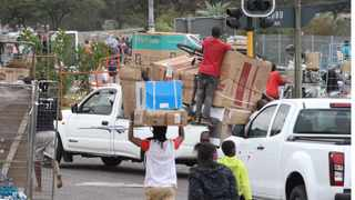Chaos on Nandi Drive near Newlands East, in Durban as hundreds of motorists take up a stretch about a kilometre with their cars as they are busy looting a game stores warehouse. File Picture: Doctor Ngcobo/African News Agency(ANA)