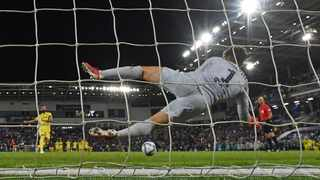 Chelsea's Spanish goalkeeper Kepa Arrizabalaga dives to save the penalty of Villarreal's Spanish defender Raul Albiol (L) to win the penalty shoot out in the Super Cup. Paul Ellis/AFP