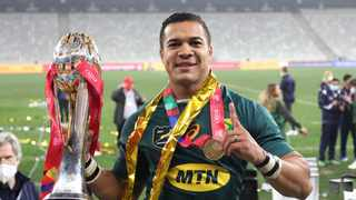Cheslin Kolbe holds aloft the series trophy after beating the The British and Irish Lions Photo: Gavin Barker/EPA