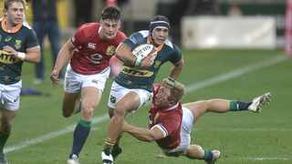 Cheslin Kolbe of the South Africa 'A' team skips past Chris Harris of the British and Irish Lions during their tour match at Cape Town Stadium. Picture: Luigi Bennett/EPA