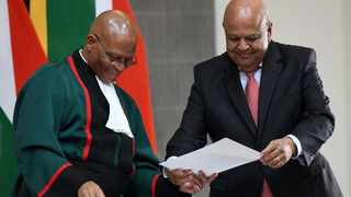 Chief Justice Mogoeng Mogoeng and Minister of Public Enterprises Pravin Gordhan. File picture: Jairus Mmutle/GCIS