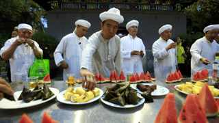 Chinese Muslims break their fast on the first day of Ramadaan at Niujie Mosque in Beijing. Picture: EPA/ How Hwee Young