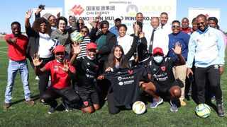Community members celebrated with the sponsors of the new sports complex in De Aar.